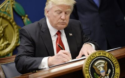 Fed up with Congress, Trump whacks Obamacare with his pen